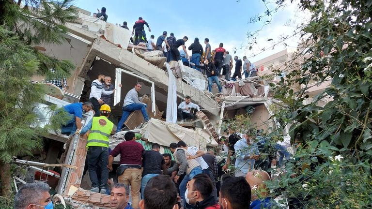 Local people and officials search for survivors in Izmir