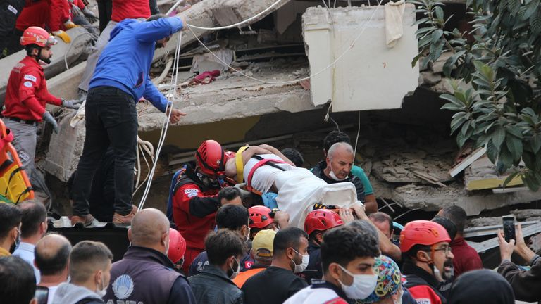Rescuers and local volunteers carry a wounded victim on a stretcher from a collapsed building after a powerful earthquake struck Turkey's western coast and parts of Greece, in Izmir, on October 30, 2020. - A powerful earthquake hit Turkey and Greece on October 30, killing at least six people, levelling buildings and creating a sea surge that flooded streets near the Turkish resort city of Izmir. Via Getty Image