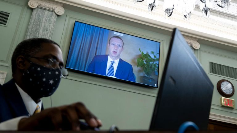 WASHINGTON, DC - OCTOBER 28: CEO of Facebook Mark Zuckerberg appears on a monitor behind a stenographer as he testifies remotely during the Senate Commerce, Science, and Transportation Committee hearing 'Does Section 230's Sweeping Immunity Enable Big Tech Bad Behavior?', on Capitol Hill, October 28, 2020 in Washington, DC. CEO of Twitter Jack Dorsey; CEO of Alphabet Inc. and its subsidiary Google LLC, Sundar Pichai; and CEO of Facebook Mark Zuckerberg all testified virtually at the hearing. Sec
