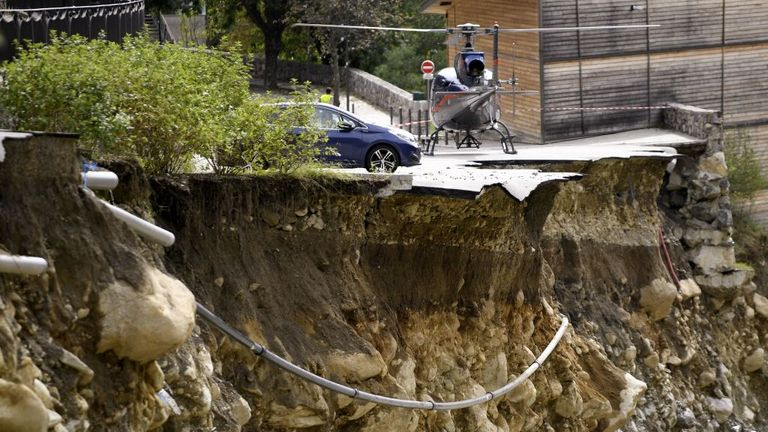 A helicopter lands on a collapsed car park in Saint-Martin-de-Vesubie