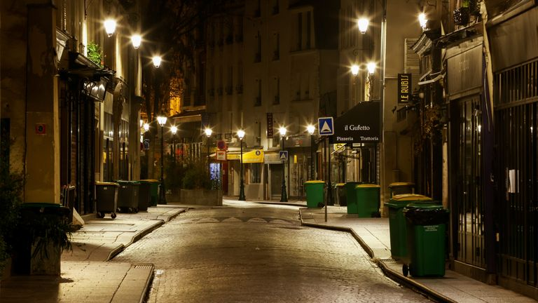 Paris is pictured empty as it enters lockdown early on Friday morning