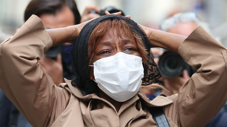 """A relative of the sacristan victim of a knife attack cries in front of the Basilica of Notre-Dame de Nice in Nice on October 29, 2020. - France's national anti-terror prosecutors said Thursday they have opened a murder inquiry after a man killed three people at a basilica in central Nice and wounded several others. The city's mayor, Christian Estrosi, told journalists at the scene that the assailant, detained shortly afterwards by police, """"kept repeating 'Allahu Akbar' (God is Greater) even whil"""