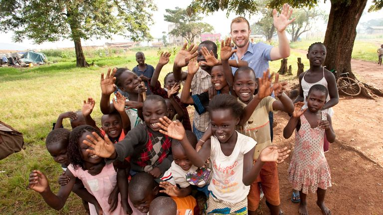 Gary Barlow poses with local children in Uganda