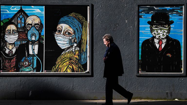 GLASGOW, SCOTLAND - SEPTEMBER 18: Members of the public walk past coronavirus posters in the Merchant City on September 18, 2020 in Glasgow, Scotland. On September 2, residents of the Glasgow area were told not to host other households inside their homes. Since then, NHS Scotland has recorded 1,218 new cases of the coronavirus in the area. (Photo by Jeff J Mitchell/Getty Images)