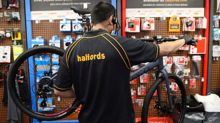 An employee works on a bicycle in a Halfords store, after the government announced a new plan on walking and cycling projects, following the coronavirus disease (COVID-19) outbreak, in Luton, Britain July 28, 2020