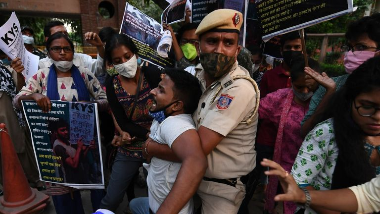 Police clash with protesters after the alleged cremation of the victim's body against her family's wishes