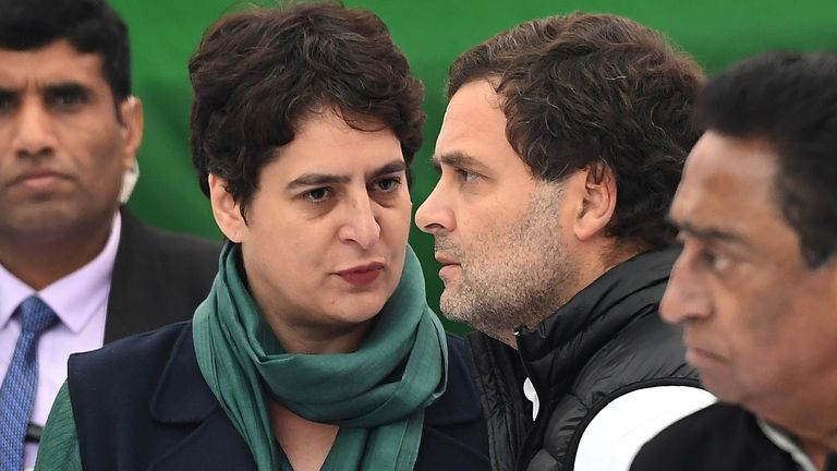 Rahul Gandhi (R) talks with his sister Priyanka Gandhi Vadra at a protest in New Delhi in December