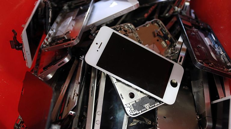 A picture taken on November 7, 2014 in Brive, southern France, shows smartphones screens in the Love2recycle.fr recycling company. The company collects and repairs all kind of smartphones before bringing them to the market. AFP PHOTO / NICOLAS TUCAT (Photo credit should read NICOLAS TUCAT/AFP via Getty Images)