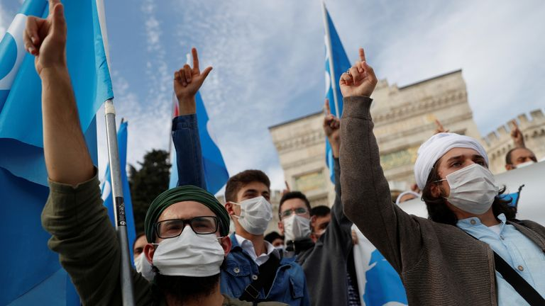 Mask-wearing protesters are seen at a demonstration in Istanbul on Sunday