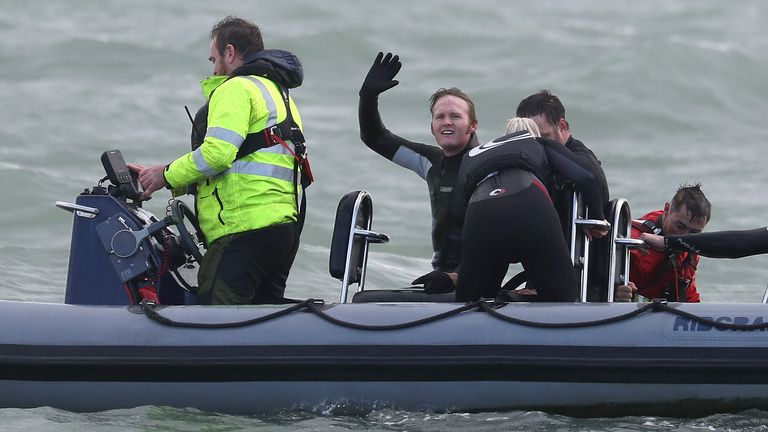 Mr Bream waves after setting the record for the highest jump into water from an aircraft