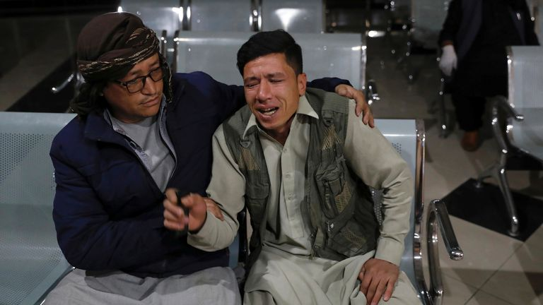 An Afghan man who lost his brother mourns at a hospital after a suicide bombing in Kabul, Afghanistan October 24, 2020.REUTERS/Mohammad Ismail