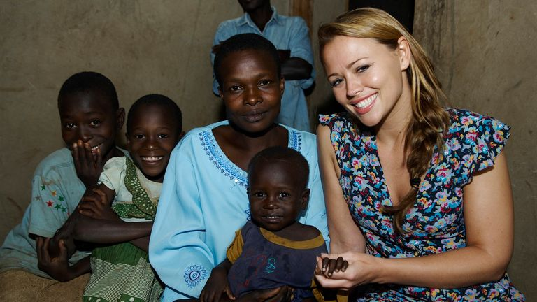 Girls Aloud star Kimberley Walsh poses with a family