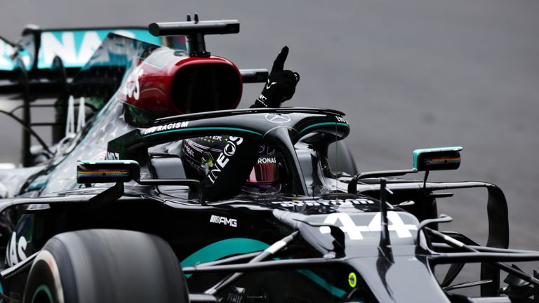Lewis Hamilton holds his finger in the sky after winning his 92nd Grand Prix