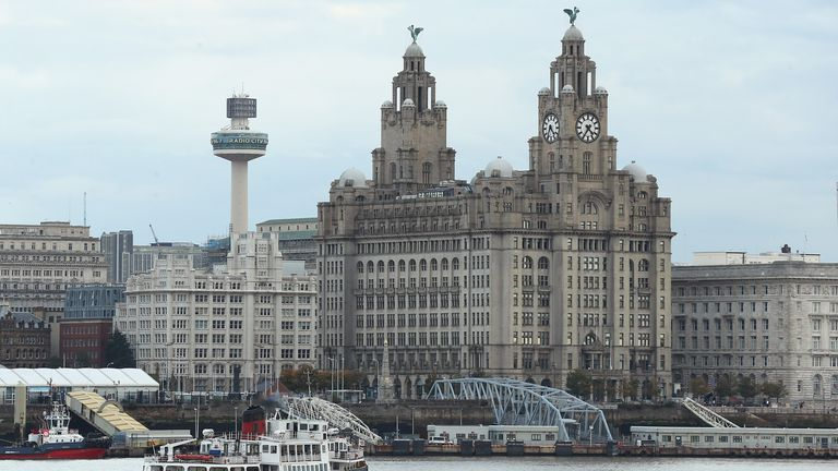 A passenger ferry is seen in front of the Liverpool waterfront on October 14, 2020 in Liverpool, England. The Liverpool City Region was placed into the highest tier of the government's new three-tier system to assess Covid-19 risk, a designation which forced the area to close pubs and ban household mixing, among other restrictions