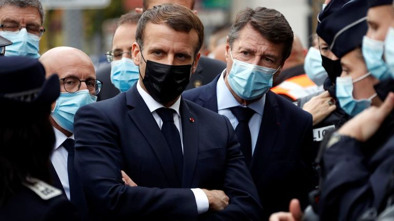 French President Emmanuel Macron (2nd-L), Right-wing party Les Republicains (LR) MP Eric Ciotti (1st-L) and Nice Mayor Christian Estrosi (3rd-L) visit the scene of a knife attack at the Basilica of Notre-Dame de Nice in Nice on October 29, 2020. - France's national anti-terror prosecutors said Thursday they have opened a murder inquiry after a man killed three people at a basilica in central Nice and wounded several others. The city's mayor, Christian Estrosi, told journalists at the scene that