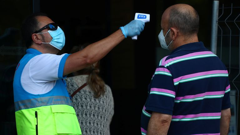 A man gets his temperature checked in Vallecas, Madrid, which has been under partial lockdown