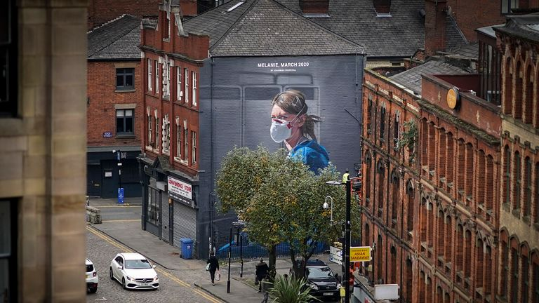 MANCHESTER, ENGLAND - OCTOBER 19: A mural depicting NHS nurse Melanie Senior, based on a photograph by Johannah Churchill on October 19, 2020 in Manchester, England. The National Portrait Gallery commissioned artist Peter Barber to create the work in Manchester's Northern Quarter. Greater Manchester's leaders including Mayor Andy Burnham will want better financial arrangements for workers affected before they agree for the region to be moved into Tier 3 Covid-19 lockdown. (Photo by Christopher F
