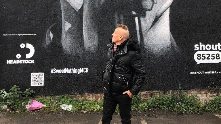 John Robb outside the Ian Curtis mural