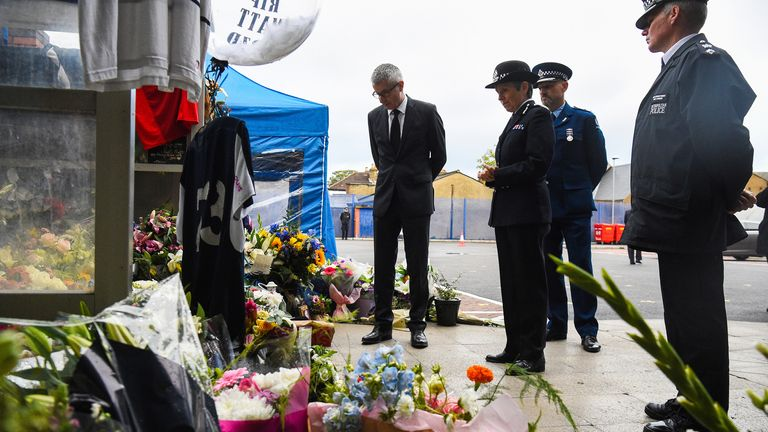 New Zealand High Commissioner to London Bede Corry (L) visits the scene where Sgt Ratana was shot