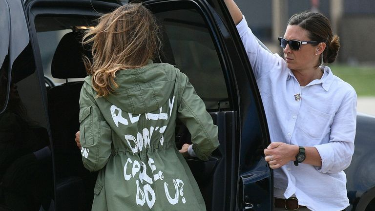 """Melania Trump wearing a jacket emblazoned with the words """"I really don't care, do you?"""" after a 2018 visit with child migrants on the US-Mexico border"""