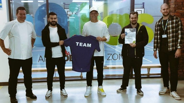 Chef Stefan Pappert, Project Manager Parsa Sadigh and Mesut Ozil with the team at Unitas