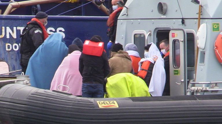 A group of people, thought to be migrants, waiting on a Border Force boat to come ashore at Dover marina in Kent, after a small boat incident in the English Channel