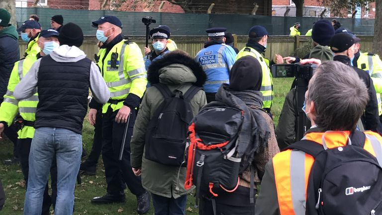 Police remove a man during a demonstration by pro-migrant supporters outside Napier Barracks in Folkestone, Kent