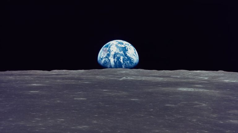 The Earth rises above the Moon's horizon, the lunar terrain is in the area of Mare Smythii (Smyth's Sea) on the nearside, in an image taken by Apollo 11, July 1969. Coordinates of the centre of the terrain here are 86 degrees east longitude and 3 degrees north latitude. (Photo by Space Frontiers/Archive Photos/Hulton Archive/Getty Images)