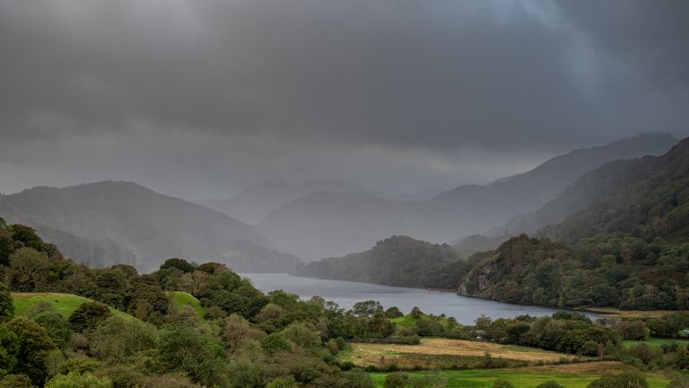 A weather front moving through Nant Gwynant with a choppy Llyn Gwynant and a moody sky n the Snowdonia National Park, UK