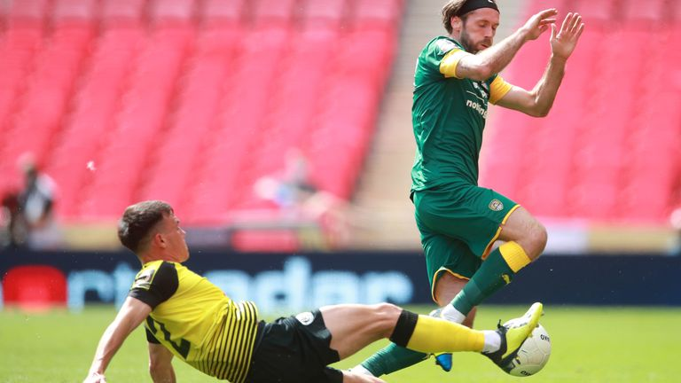 Harrogate Town's Ryan Fallowfield (left) and Notts County's Jim O'Brien battle for the ball during the Vanarama National League play-off final at Wembley Stadium, London. PA Photo. Picture date: Sunday August 2, 2020