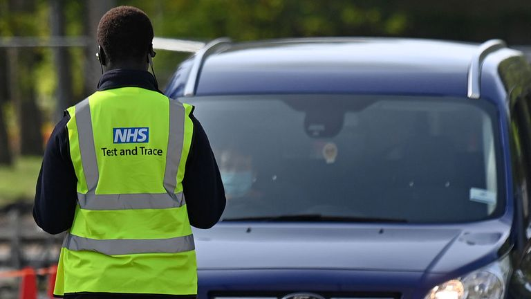 An NHS worker is seen wearing a Test and Trace jacket at Lee Valley Athletics Centre in Edmonton