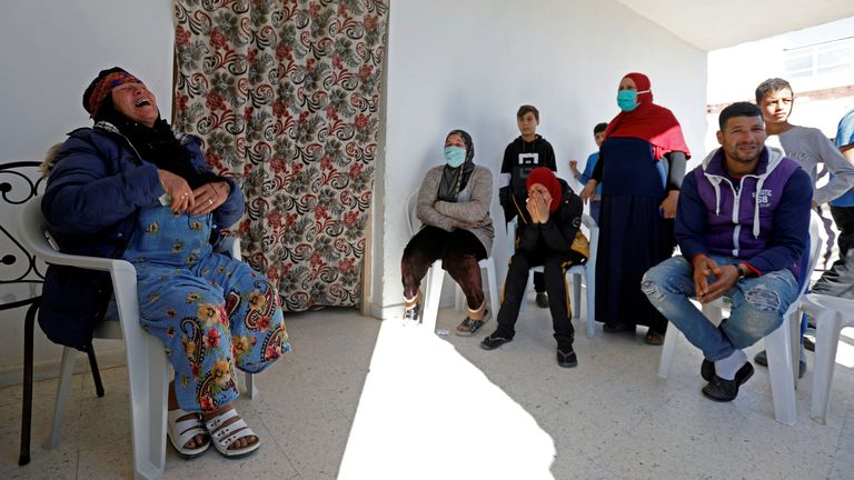 Brahim Aouissaoui's relatives gathered at the family home in Thyna, a suburb of Sfax in Tunisia, with his mother, Gamra Issawi (L)