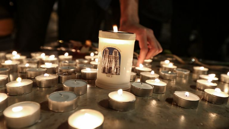 Candles have been lit outside the church