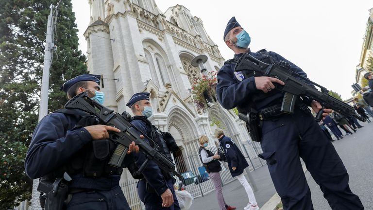 Police officers stand guard at the Notre Dame church