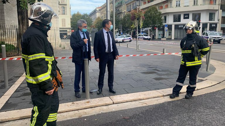 Nice Mayor Christian Estrosi talks to Municipal Police at the site of a knife attack