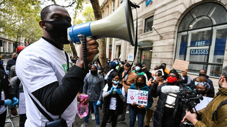 Protesters against SARS in London on 11 October