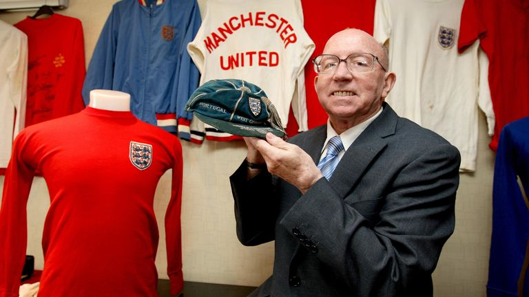 Nobby Stiles holds his 1966 World Cup tournament cap in 2010