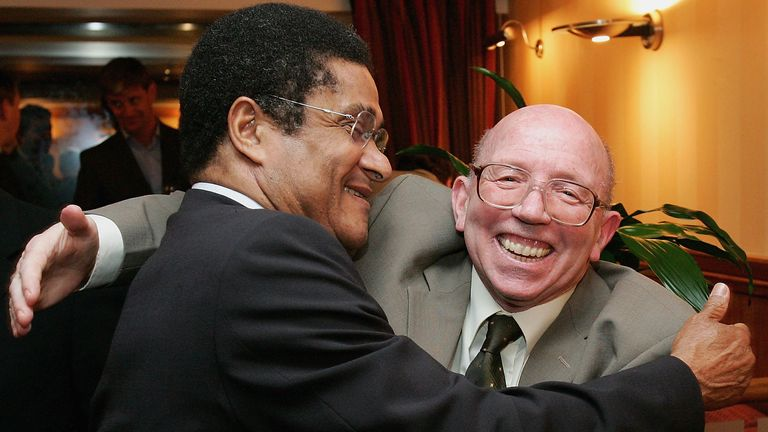 Nobby Stiles greets Eusebio at a Manchester United and Benfica reunion dinner