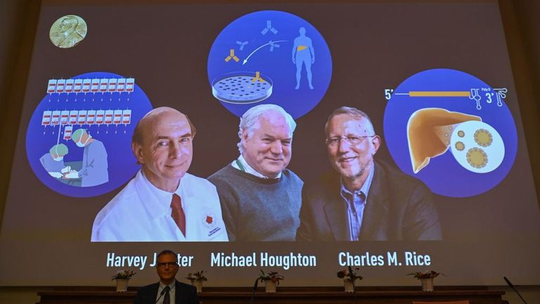 Nobel Committee member Patrik Ernfors sits in front of a screen displaying the winners of the 2020 Nobel Prize in Physiology or Medicine, (L-R) American Harvey Alter, Briton Michael Houghton and American Charles Rice, during a press conference at the Karolinska Institute in Stockholm, Sweden, on October 5, 2020. - Americans Harvey Alter and Charles Rice as well as Briton Michael Houghton win the 2020 Nobel Medicine Prize for the discovery of Hepatitis C virus. (Photo by Jonathan NACKSTRAND / AFP