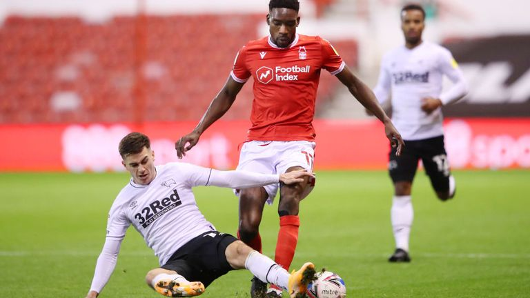 Sammy Ameobi of Nottingham Forest, right, is challenged by Tom Lawrence of Derby County during a match between the teams last night