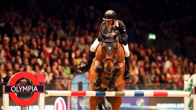 William Whitaker RMF Cadeau de Muze competes in the Turkish Airlines Olympia Grand Prix during day seven of The London International Horse Show at London Olympia