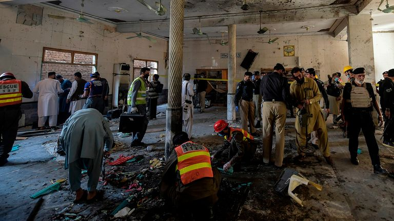 Security officials examine the site of a blast at a religious school in Peshawar on October 27, 2020. - At least four students were killed and dozens more wounded on October 27 when a bomb exploded during a class at their religious school in Pakistan, officials said. (Photo by Abdul MAJEED / AFP) (Photo by ABDUL MAJEED/AFP via Getty Images)
