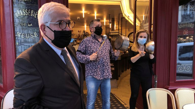 Marcel Benezet, head of the GNI cafes and restaurants branch, stands with French restaurants workers, wearing black armbands and hitting pots, durint a protest in front their restaurant La Ville de Provins in Paris as part of a day of actions to urge French authorities to avoid closures or restrictions to fight the coronavirus disease (COVID-19) outbreak in France