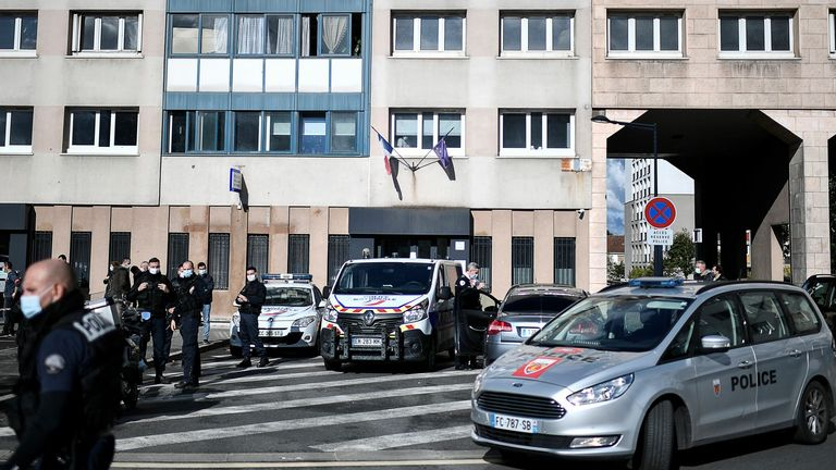 Police officers outside the police station of Champigny-sur-Marne after the attack