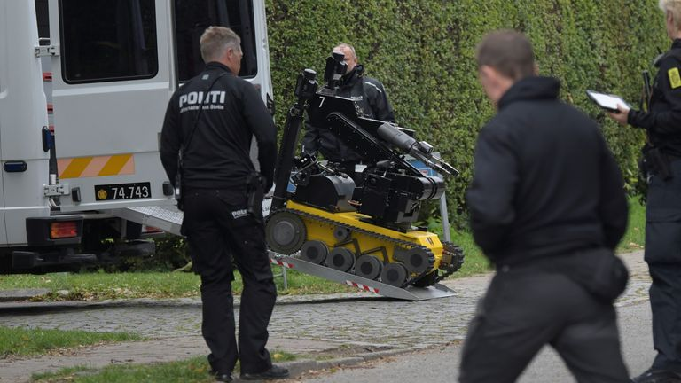 Police officers are seen as Peter Madsen (not pictued) is surrounded by the police in Albertslund, Denmark October 20, 2020. Ritzau Scanpix/Nils Meilvang via REUTERS ATTENTION EDITORS - THIS IMAGE WAS PROVIDED BY A THIRD PARTY. DENMARK OUT. NO COMMERCIAL OR EDITORIAL SALES IN DENMARK.