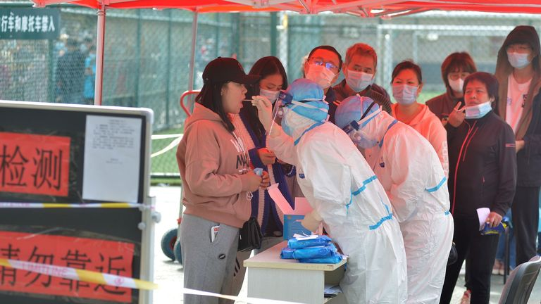 Medical workers in protective suits collect swab tests in Qingdao