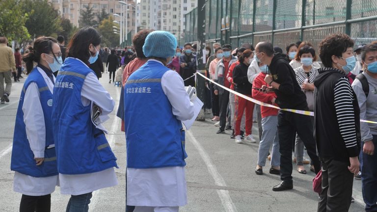 People line up at a coronavirus testing site in Qingdao following the report of new cases