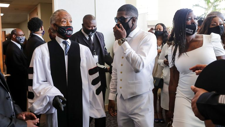 Quincy Floyd (R) pictured with Rev Al Sharpton at his father's funeral