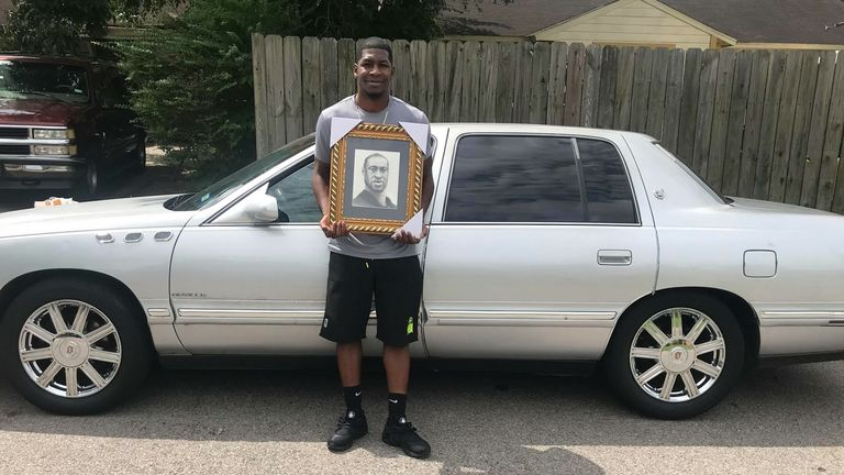 Quincy, 28, is pictured in front of his father's old car