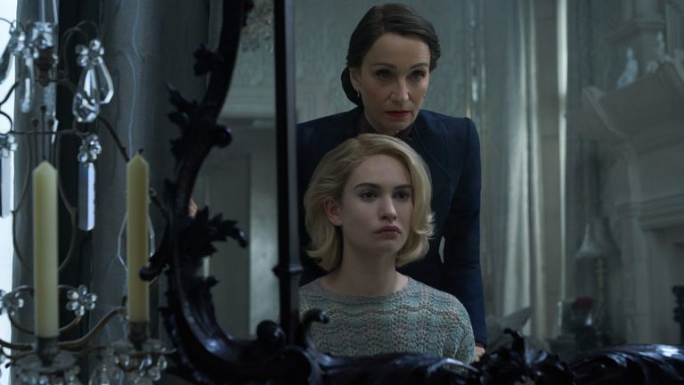 Lily James as Mrs de Winter, Kristin Scott Thomas as Mrs Danvers in Rebecca. Pic: Kerry Brown/ Netflix